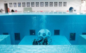 "Belgians Florence Lutje Spelberg and Nicolas Mouchart dive next to ""The Pearl"", a spheric dining room placed 5 metres underwater in the NEMO33 diving center, one of the world's deepest pools (33 metre/36 yards) built to train professional divers, before enjoying a meal inside, in Brussels, Belgium January 30, 2017. Picture taken January 30, 2017 REUTERS/Yves Herman"
